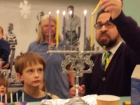 Watching the menorah being lit